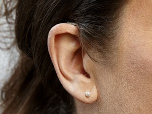Virtually invisible hearing aid technology